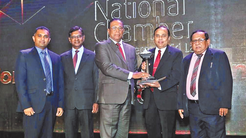 Pussalla  Chairman Philip J. Wewita  receiving the Environmental suitability excellence award from  Waruna Mallawarachchi, DGM (Marketing), Associated News Papers of Ceylon Limited Sunil G. Wijesingha Chairman  Panel of Judges, Dilshan J. Wewita Managing Director and Dr. Premasiri General Manager of Pussalla look on.