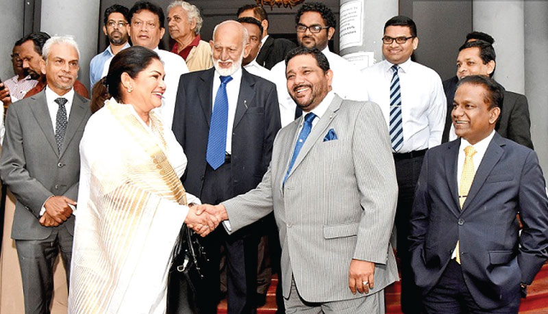 Colombo Mayoral candidates Rosy Senanayake (UNP) and Azath Salley (UPFA) wish each other good luck for the February 10 local government elections after handing in their nomination papers outside the New Town Hall Colombo yesterday. Picture by Rukmal Gamage