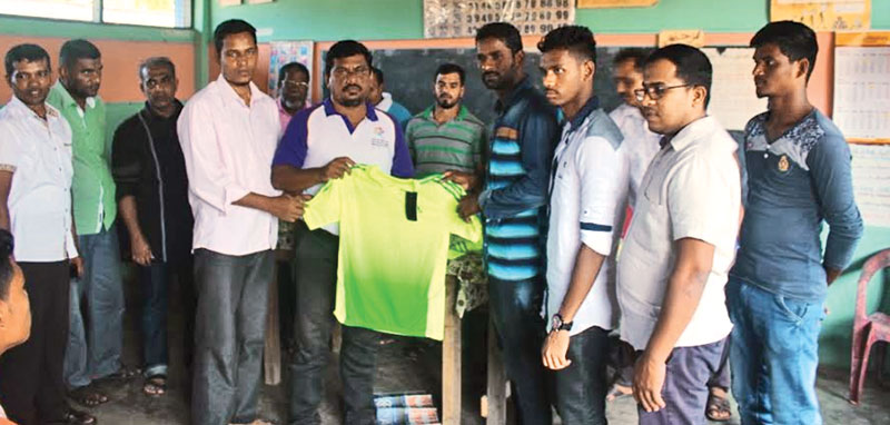 The Hyland Sports Club, Addalaichenai football team receiving the new jersey.