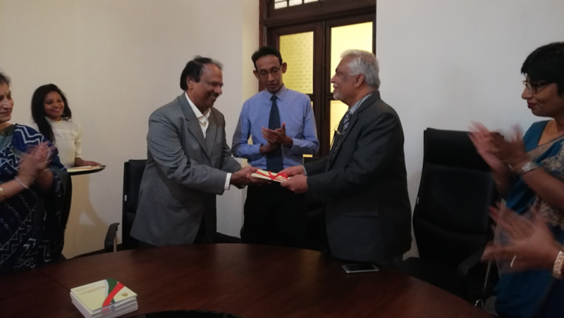Prof. Mohammed Gulrez presenting his monograph to Colombo University VC Prof. Lakshman Dissanayake at College House. Founding Director of the Centre for Contemporary Indian Studies Prof. Sandagomi Coperahewa and others look on.