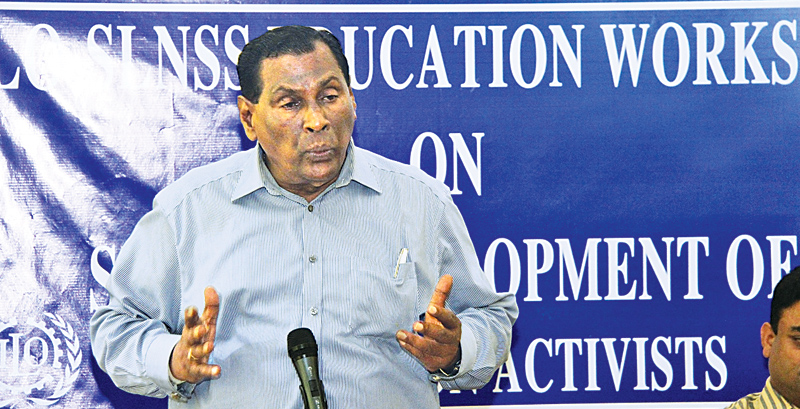 Labour and Trade Union Relations Minister W. D. J. Seneviratne addressing the gathering.