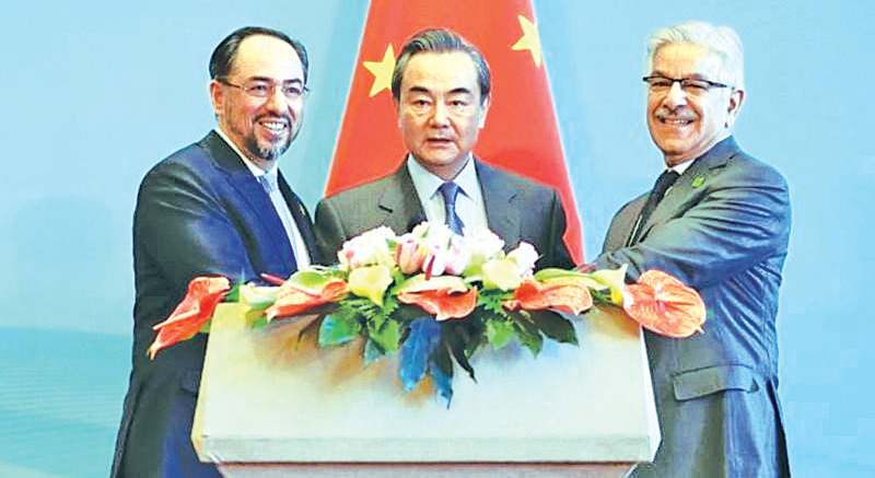 Chinese Foreign Minister Wang Yi hosted trilateral talks in Beijing between Pakistani Foreign Minister Khawaja Asif and Afghan Foreign Minister Salahuddin Rabbani in Beijing on Tuesday. - AFP