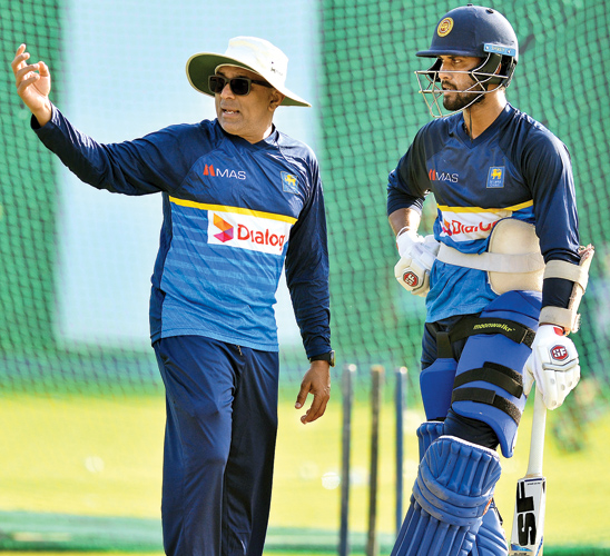 Chandika Hathurusingha give a few batting tips to Sri Lanka's Test captain Dinesh Chandimal at the R Premadasa Stadium yesterday. Picture by Tilak Perera