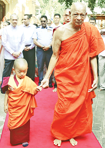His Holiness Vairotsana Truklu Jigme Jigten Wangchuck of Bhutan accompanied by his mother Her Royal Highness Ashi Sonam Dechan Wangchuck visited the Gangaramaya Temple yesterday to pay their respects to the Sacred Bodhi tree. Picture shows the Chief Incumbent of Hunupitiya Gangaramaya Ven Galaboda Gnanissara Thera  escorting  His Holiness Vairotsana Truklu Jigme Jigten Wangchuck to the temple. Picture by Rukmal Gamage