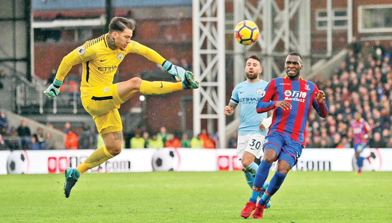 Manchester City's Ederson in action with Crystal Palace's Christian Benteke.