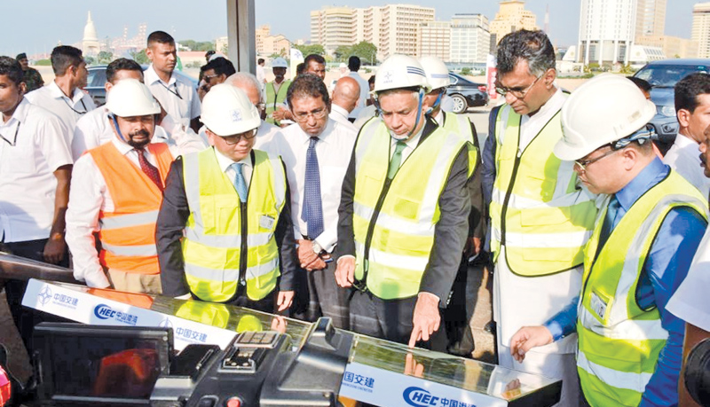 Prime Minister Ranil Wickremesinghe, accompanied by Megapolis and Western Development Minister Patali Champika Ranawaka, Policy Planning and Economic Development Deputy Minister Dr. Harsha de Silva and others at Port City Colombo construction site. Picture by Hirantha Gunathilaka.