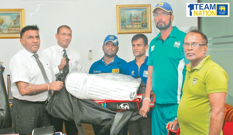 Sri Lanka Cricket's vice president, K. Mathivanan hands over the sponsorship to Sri Lanka blind team manager H.G. Chaminda Pushpakumara Karunaratne at the SLC headquarters. Chinthaka Edirimanne, Head of Operations of SLC domestic cricket is also present.