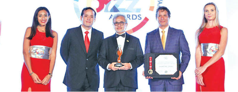 Kishore Surtani with the 'top SME in Asia' award at the Asia Corporate Excellence and Sustainability Awards (ACES)