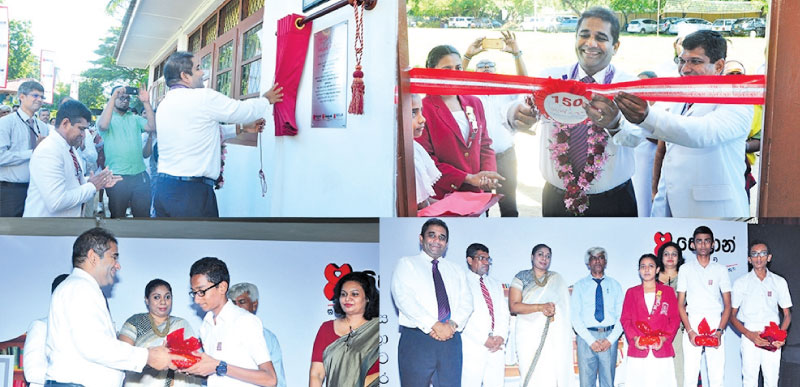 "Director and CEO Kapila Ariyaratne unveils the plaque of 150th ""Seylan Pahasara' Library Opening at C.W. W. Kannangara Vidyalaya, Colombo 08."