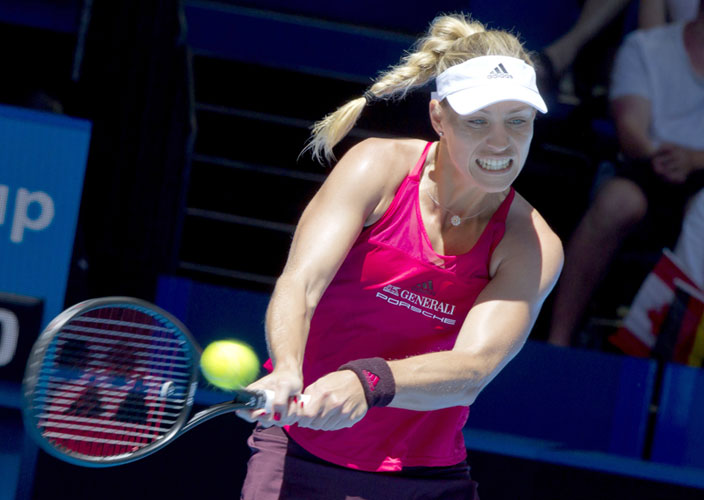 Angelique Kerber of Germany hits a return against Eugenie Bouchard of Canada during their seventh session women's singles match on day five of the Hopman Cup tennis tournament in Perth on January 3. AFP