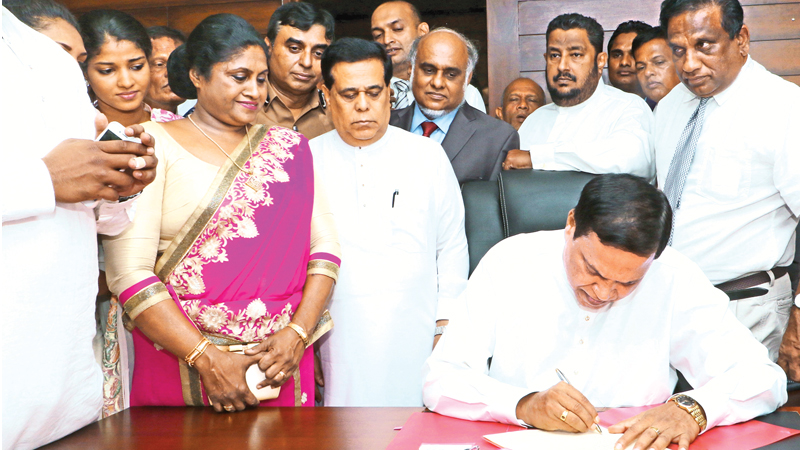 Newly sworn-in Law and Order and Southern Development State Minister Piyasena Gamage assuming duties. Picture by Saman Sri Wedage.