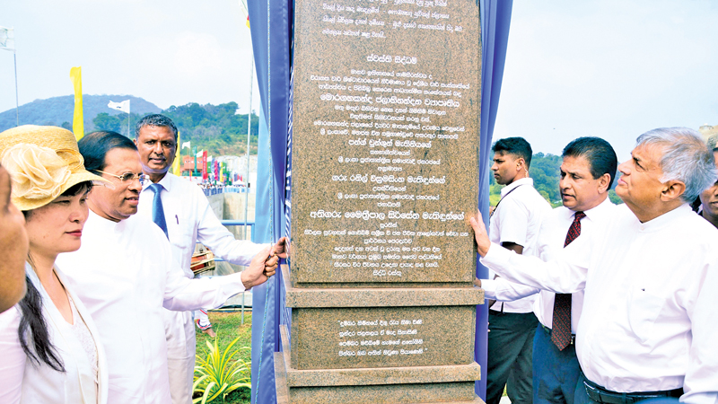 The President and Prime Minister declare open the plaque at the Moragahakanda dam. Pictures by Sudath Malaweera and Sudaath Silva