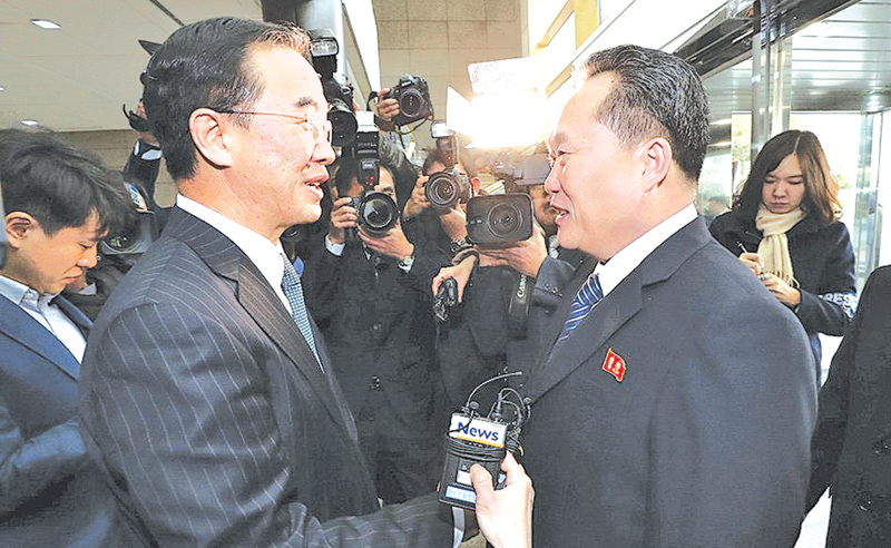 Head of the North Korean delegation Ri Son Gwon shakes hands with his South Korean counterpart Cho Myoung-gyon before their meeting at the truce village of Panmunjom in the demilitarized zone separating the two Koreas yesterday. - AFP