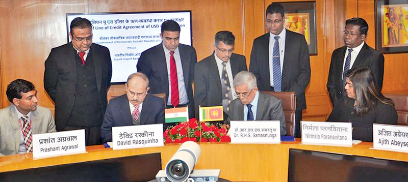Export-Import Bank of India Managing Director David Rasquinha and the Treasury Secretary signing the agreement.