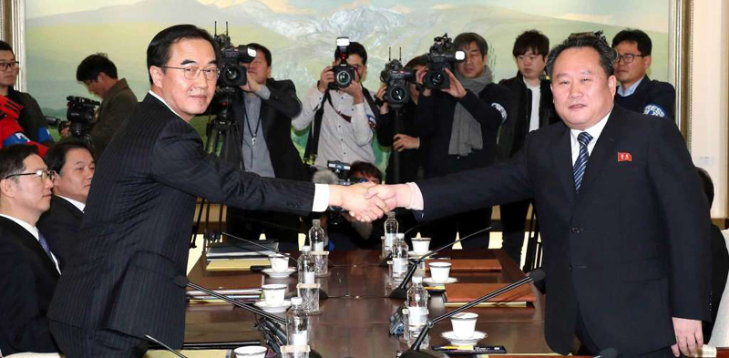 South Korean Unification Minister Cho Myoung-gyon, (L), shakes hands with the head of North Korean delegation Ri Son Gwon before their meeting at the Panmunjom in the Demilitarized Zone in Paju, South Korea on Tuesday.