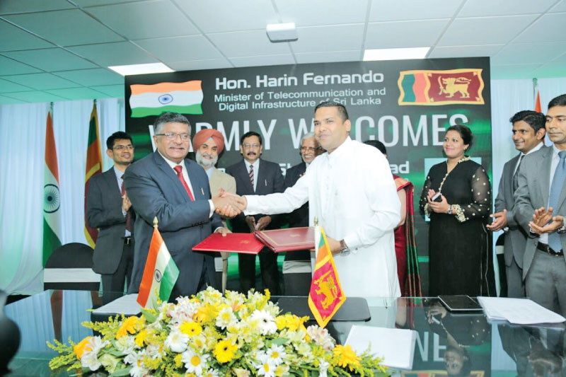 The MoU exchanged by Ravi Shankar Prasad, Minister of Law and Justice and Electronics and Information Technology of India and Harin Fernando, Minister of Telecommunication at the Ministry. Picture by Saliya Rupasinghe
