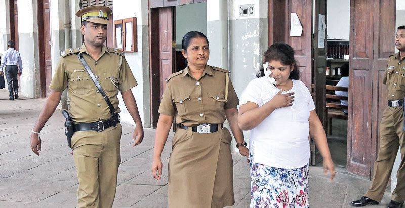 Accused Selvakumari Sathyaseelan being taken to Colombo High Court, yesterday. Picture by Rukmal Gamage.
