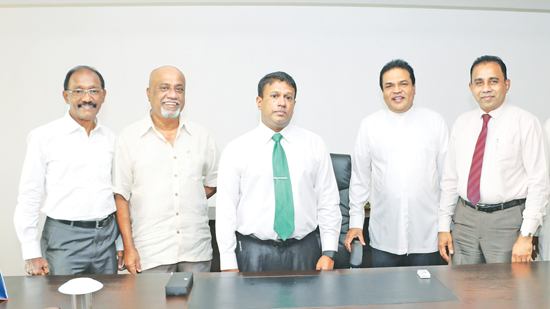 Dr. Keerthi Bandara Kotagama, after commencing duties. P Harrison, Minister of Rural Economic Affairs, Prof. H.W. Cyril, Chairman of the National Livestock Development Board, M.P.M.B. Atapatthu, Director General of Development Finance Department of Finance Ministry and Dr. Silva, Agricultural specialist look on.
