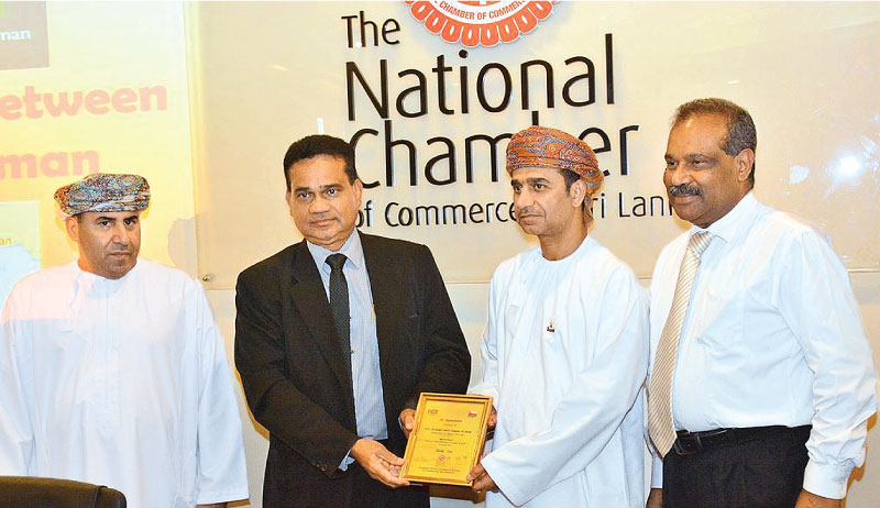 Oman Ambassador to Sri Lanka Al-Sheikh Jumah Hamdan Al-Shehhi presented a memento by officials of the National Chamber of Commerce of Sri Lanka. Picture by Sarath Pieris