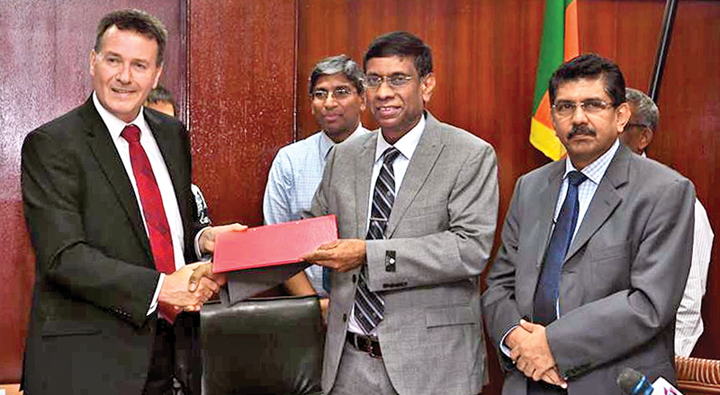 Health Ministry Secretary Janaka Sugathadasa  and Australian Ambassador Bryce Hutchesson exchanging the documents after signing the agreement.