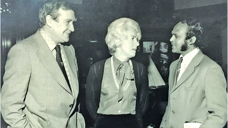 Picture shows the meeting of two spin bowlers - Elmo Rodrigopulle (right) at the Park Tower Hotel in Knightsbridge, London and Jim Laker and Mrs.S. Goodhew after a sumptuous meal.
