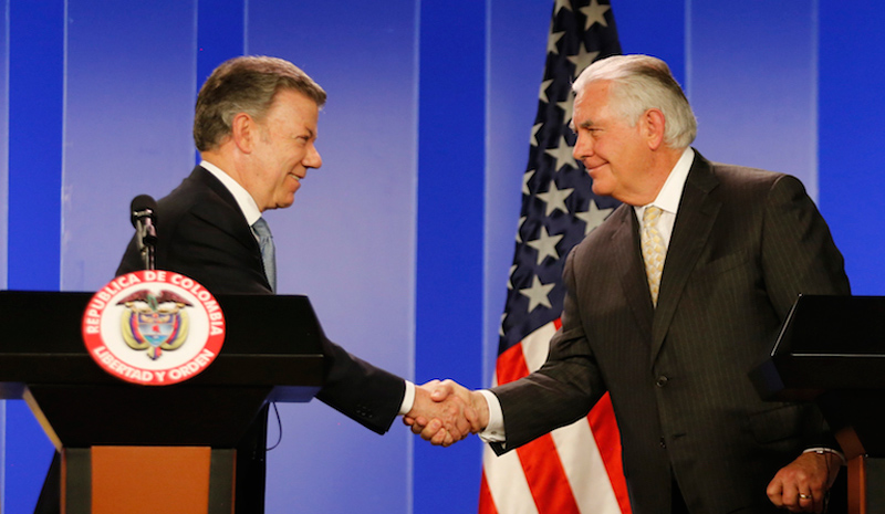 Colombian President Juan Manuel Santos, (L), shakes hands with US Secretary of State Rex Tillerson during a joint press conference after a meeting at the presidential palace in Bogotá, Colombia on Tuesday.