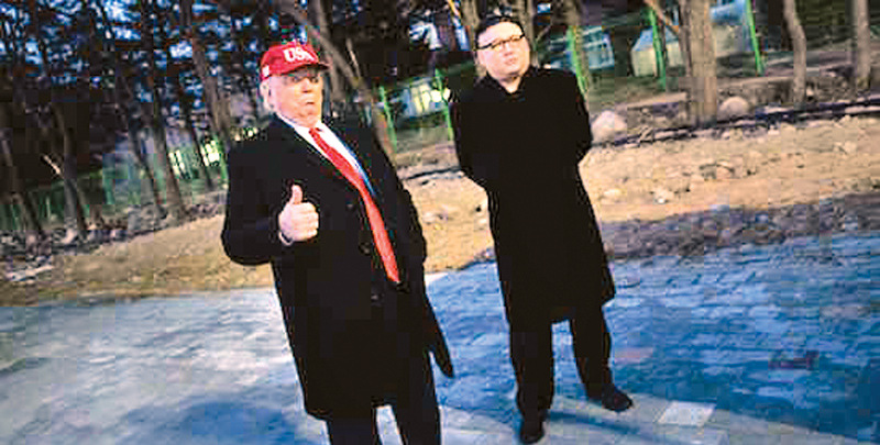 People dressed up as U.S. President Donald Trump and North Korean leader Kim Jong Un at Winter Olympic Games opening.  AFP