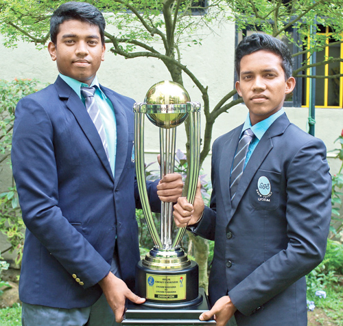 The skipper of Lyceum Nugegoda team Pasindu Rajapaksa (left) and Lyceum Panadura captain Sithira Tennekoon are seen here with Nikitha Grero Challenge Trophy. Picture by Ruwan de Silva