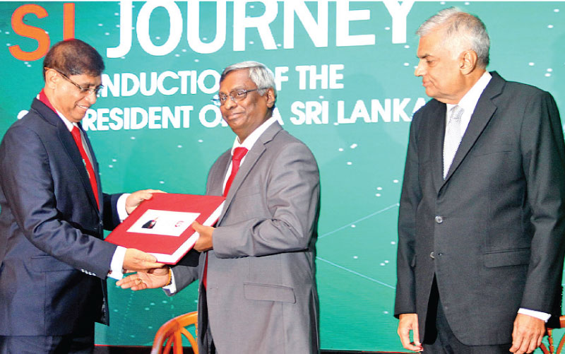 Jagath Perera was ceremonially inducted as the 24th President of the Institute of Chartered Accountants of Sri Lanka (CA Sri Lanka) in the presence of a distinguished gathering including Prime Minister Ranil Wickremesinghe. Here CA Sri Lanka President Jagath Perera handing over an album to outgoing President Lasantha Wickremasinghe which contains the immediate past president's activities and initiatives for 2016/2017. Prime Minister Ranil Wickremesinghe looks on. Picture by Sulochana Gamage