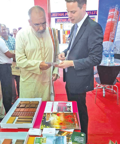 Jan Kunigk, Marketing and Sales Director / Executive Vice President of INSEE Cementbriefing about the INSEE branded cement products to C. V. Vigneswaran, Chief Minister of Northern Provincial Council.