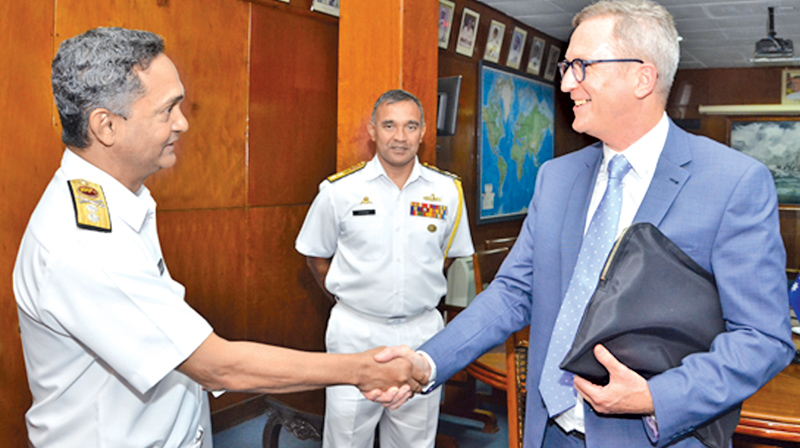 Australias ambassador for people smuggling and human trafficking sri lanka navy chief of staff rear admiral neil rosayro greeting the ambassador for people smuggling and human trafficking for australia dr geoffrey shaw m4hsunfo