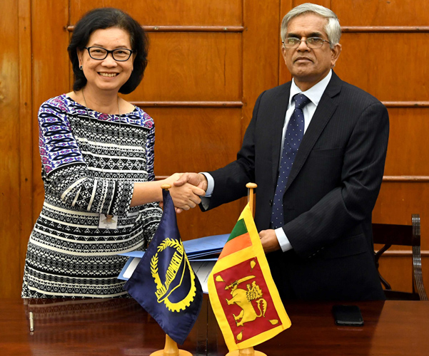 Finance Ministry and Mass Media Secretary Dr. R. H. S.Samaratunga and Ms. Sri Widowati, Country Director of ADB – Sri Lanka Resident Mission exchanging the loan agreement at the Ministry of Finance and Mass Media yesterday.
