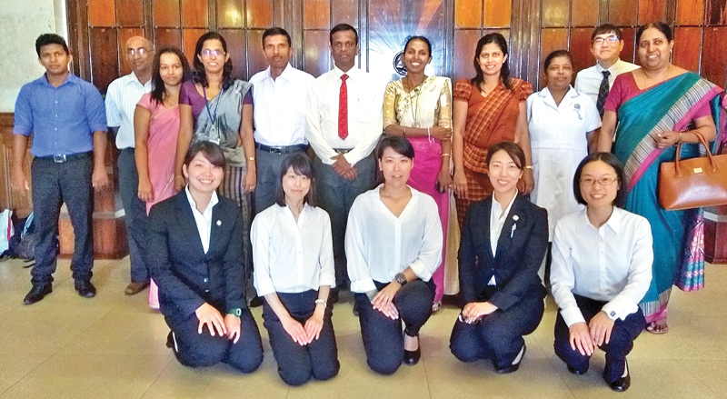 The Japanese volunteers with Sri Lankan officials at the ERD.