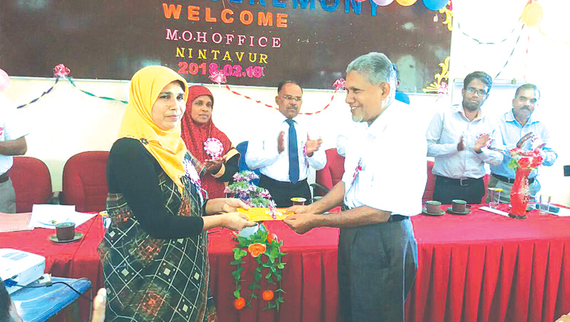 A school principal receives a certificate at the awards ceremony.