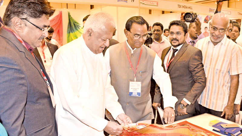 Minister Amunugama and PDEXCIL Chairman Purushottam K. Vanga and other invitees at the exhibition. Picture by Sarath Peiris