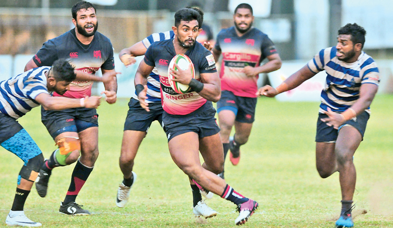 Kandy SC centre Danushka Ranjan (with ball in hand) on his way to score one of his two tries.