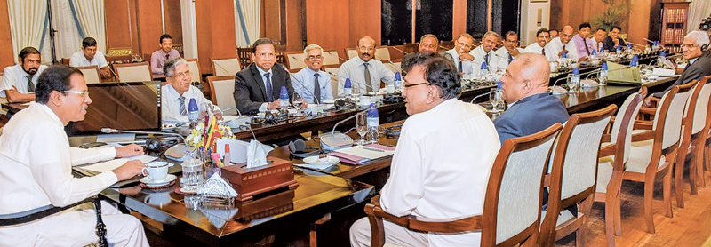 President Maithripala Sirisena addressing the heads of state banks. Ministers Mangala Samaraweera and Lakshman Kiriella, Finance Ministry Secretary Dr. R.H.S. Samaratunga, Public Enterprise Development Ministry Secretary Ravindra Hewavithrana and Central Bank Governor Dr. Indrajit Coomaraswamy were present. (Picture by President's Media Division).