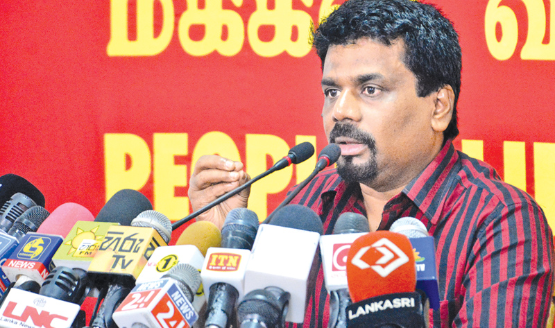 JVP MP Anura Kumara Dissanayake speaks at the press conference yesterday.