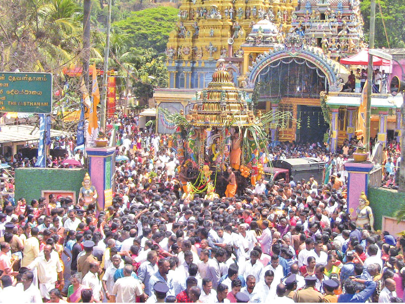 The annual Theru festival of the historic Matale Sri Muthumari Amman Temple began at the auspicious time, yesterday. The statues of Lord Murugan, Sivan Ambal, Shri Ganeshan, Shandeshulary and Goddess Pattini in beautifully illuminated and decorated chariots, drawn by devotees, both Hindus and Buddhists, were taken along the streets in procession. The procession will be conducted today too. Picture by Siri Abayasiri, Matale Central Group Corr.