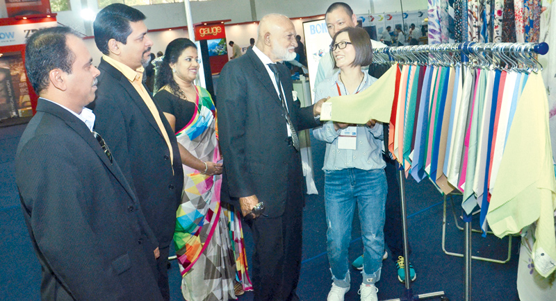 Senior Minister A. H. M. Fowzie, visiting the exhibition hall. Picture by Wimal Karunathilaka