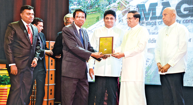 Here Chairman and Managing Director of Maga Engineering, M.G. Kularatne receiving National Awards for Construction Excellence for NSBM Green University project from President Maithripala Sirisena. Also seen are Senior Project Manager (NSBM Project) Lochana Udawatta (Left), Minister of Housing and Construction, Sajith Premadasa and Deputy Minister of Housing and Construction, Indika Bandaranayake.