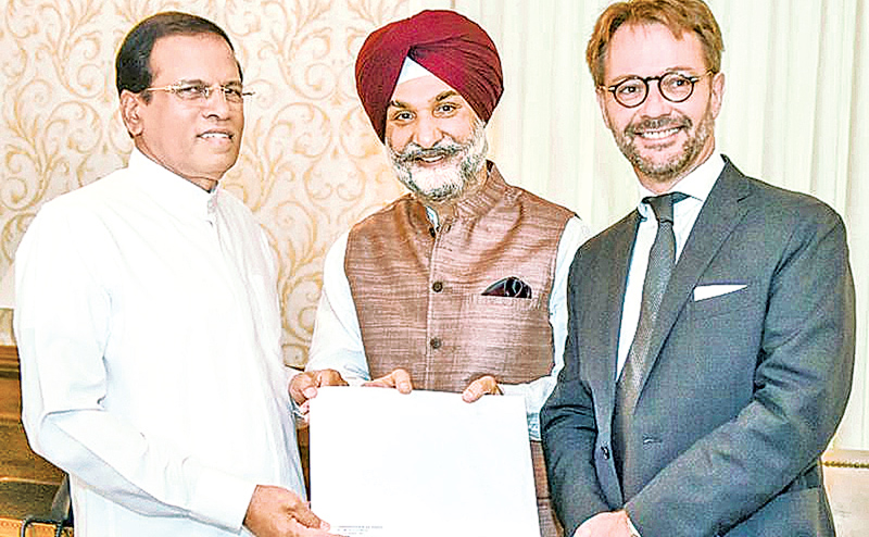 High Commissioner of India Taranjit Singh Sandhu and Ambassador of France Jean-Marin Schuh present the invitation to President Maithripala  Sirisena.