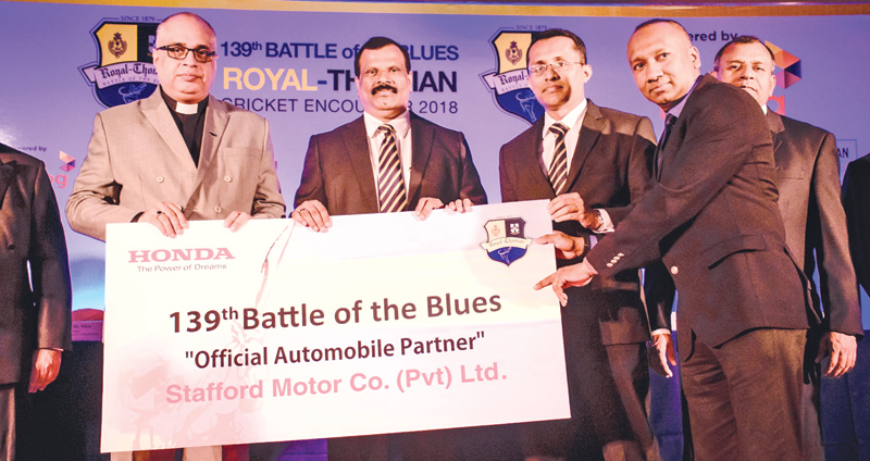 Stafford Motor's Director/Chief Operating Officer - Charaka Perera and General Manager - Automobile - Sanjeeve Gooneratne (right) handing over the sponsorship cheque to B.A. Abeyrathne - Principal Royal, College and Rev. Marc Billimoria - Warden of S. Thomas' College