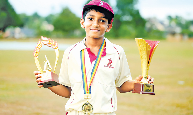 Sharu Shanmuganathan displays his two awards won at the tournament.