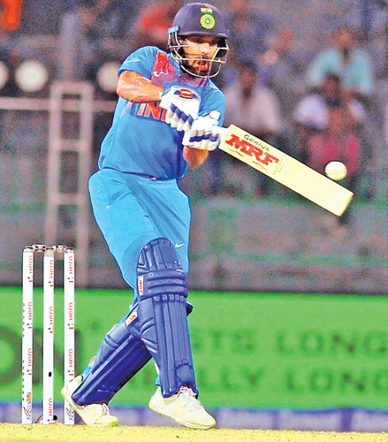Indian opener Shikhar Dhawan drives for runs in the Hero Nidahas trophy tri-series T20 match against Bangladesh at the R Premadasa Stadium yesterday. Picture by Susantha Wijegunasekara