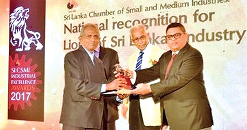 Aruna Engineering Industries receiving the award from Head of Central Bank, Dr. Indrajith Kumaraswami.