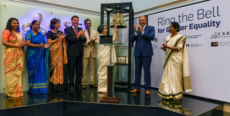 Professor Maithree Wickremesinghe 'Rings the Bell' for gender equality at the Colombo Stock Exchange with Australian High Commissioner Bryce Hutchesson, IFC Country Manager Amena Arif and Chairman-designate of the United Nations Global Compact Dilhan Fernando.