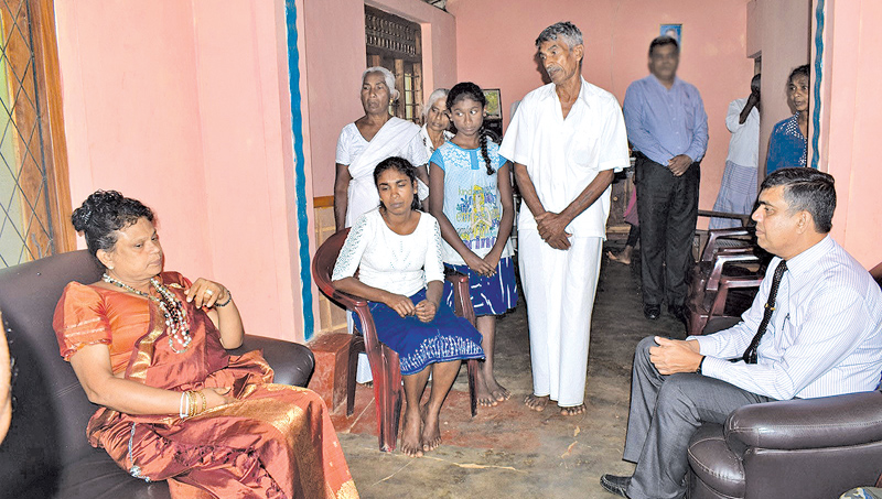 Central Province Governor Niluka Ekanayake in conversation with H.B.Kumarasinghe's family members.