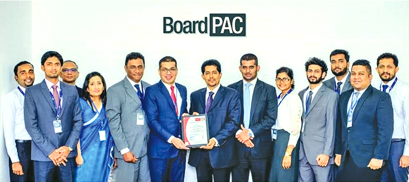 Rajitha Kuruppumulle – Chief Operating Officer of BoardPAC (6th from left), with Shan Nanayakkara – General Manager and Gayan Balachandra – Manager- Sales and Marketing of Bureau Veritas and representatives of the BoardPAC ISO Committee at the presentation of the 1SO/IEC 27001:2013 information security certification for the fourth consecutive year.
