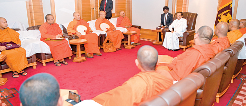 A meeting was held between the Chief incumbents of the Sri Lankan Buddhist temples in Japan with President Maithripala Sirisena yesterday, during the latter's official visit to Japan. Foreign Affairs Minister Thilak Marapana, Minister Nimal Siripala de Silva, Minister Malik Samarawickrama and parliamentarian Arshu Marasinghe were also present at the occasion. Picture by Sudath Silva